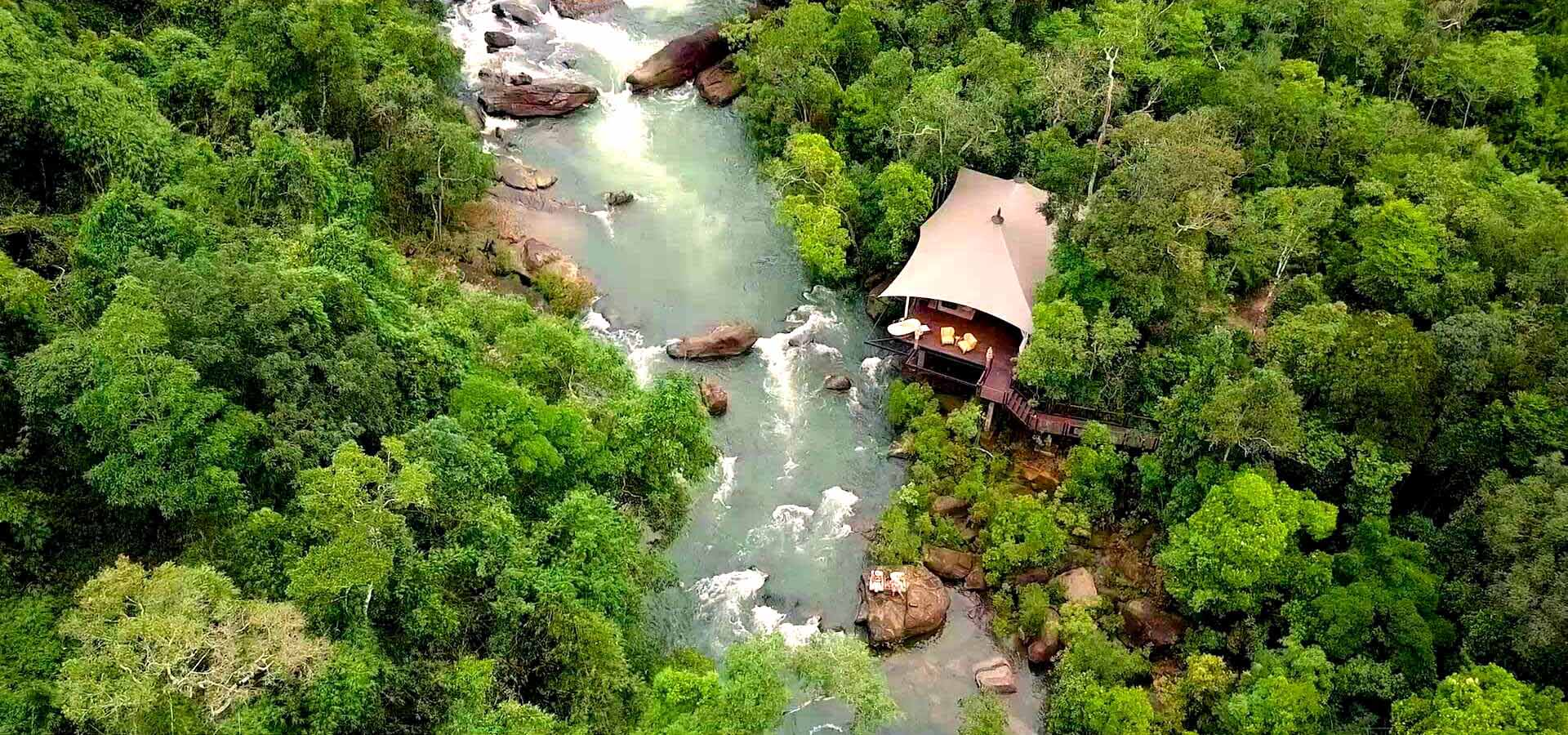 Aerial view Shinta Mani Wild Luxury Tented Camp and river