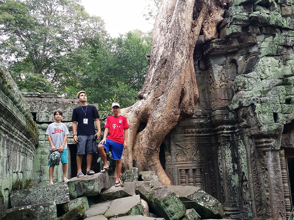 Kids exploring Ta Phtom temple in Angkor, Cambodia