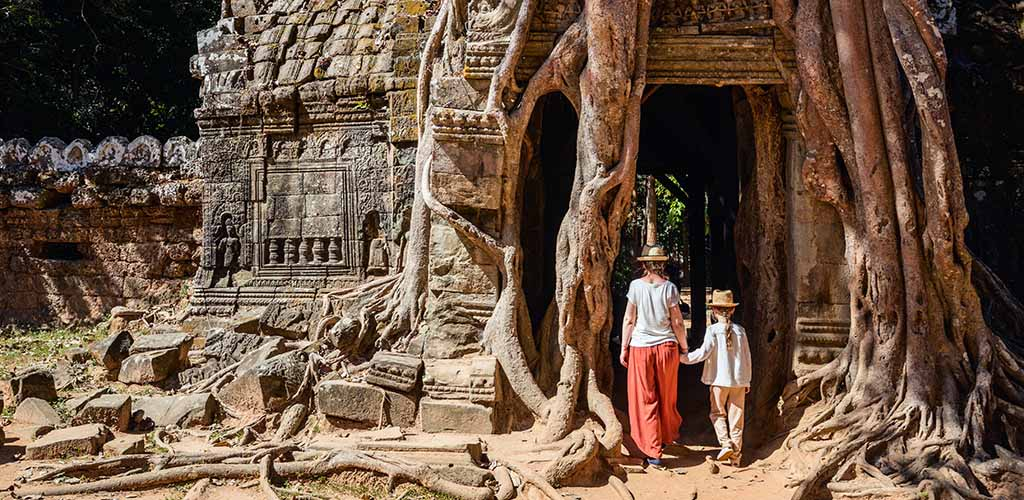 Family at Ta Phrom temple in Cambodia