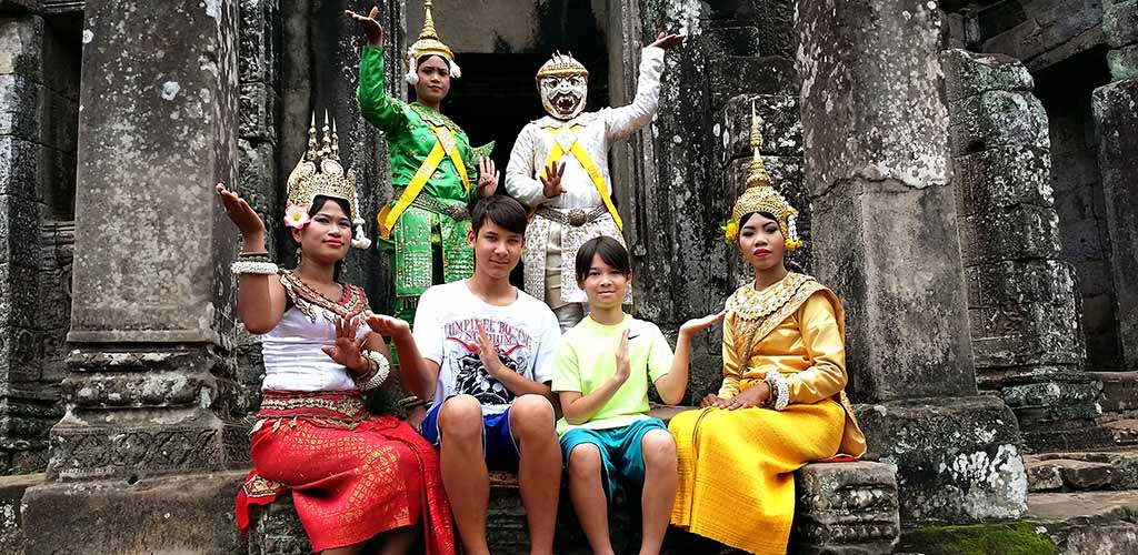 Posing with traditional Khmer dancers in Angkor, Cambodia