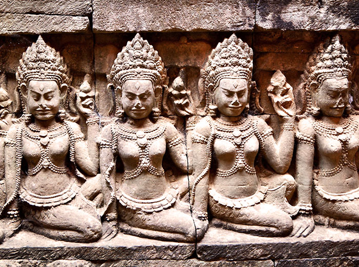 Carved stone apsaras in temple of Angkor Thom, Cambodia