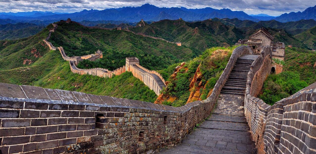 Great wall of China meandering across mountains