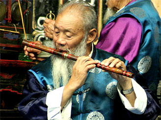 Naxi flutist in Lijiang, China