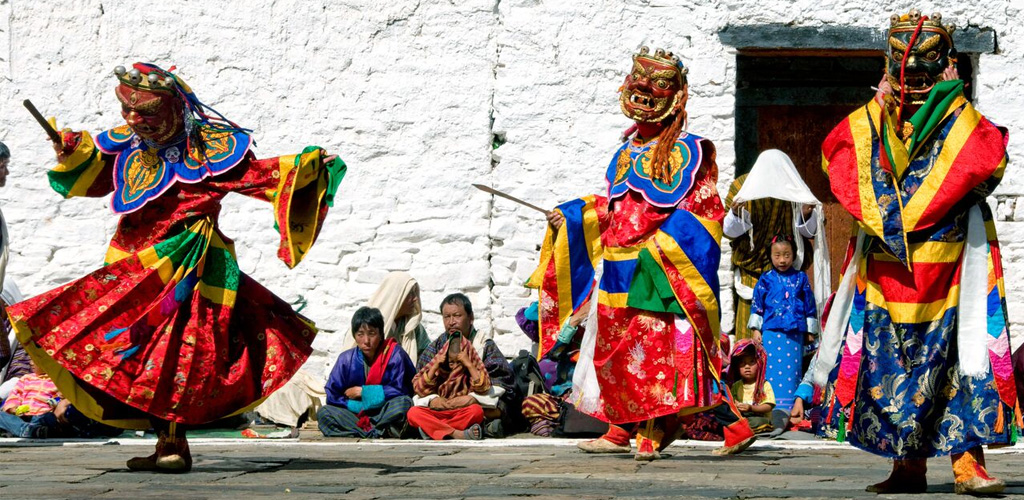 Masked dancers at Bhutan annual festival