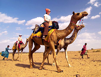Camel safari riders in Rajasthan, India