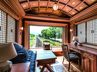 Japan Seven Stars luxury train deluxe suite with rear view