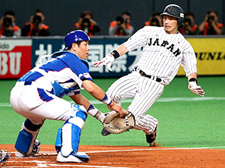 Tokyo Giants baseball player sliding into home plate
