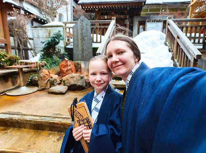 Mother and daughter on family tour in Japan
