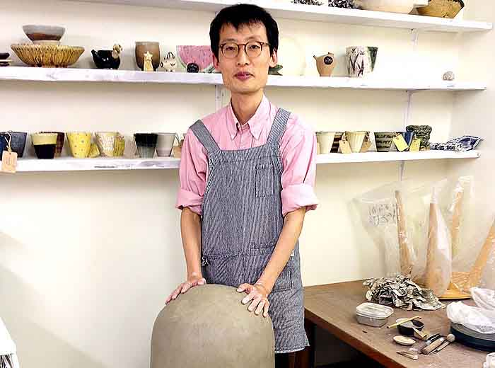 Japanese pottery make in his shop