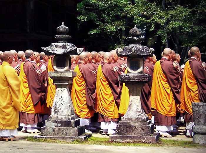 Monks in prayer at Zen temple in Kyoto, Japan