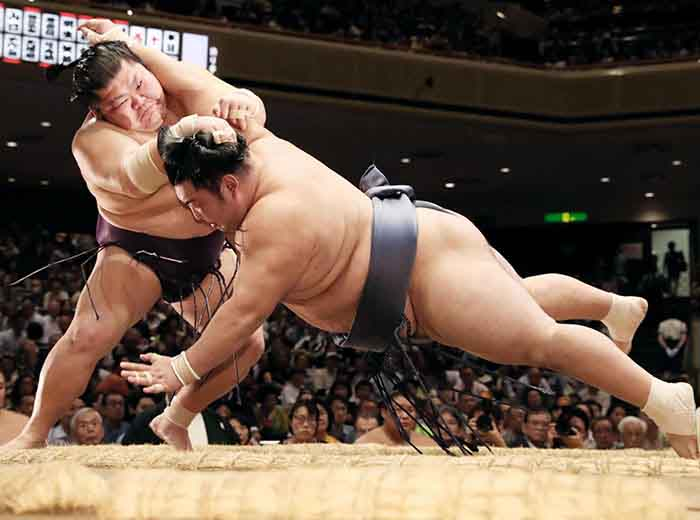 Sumo wrestlers doing battle in Tokyo, Japan