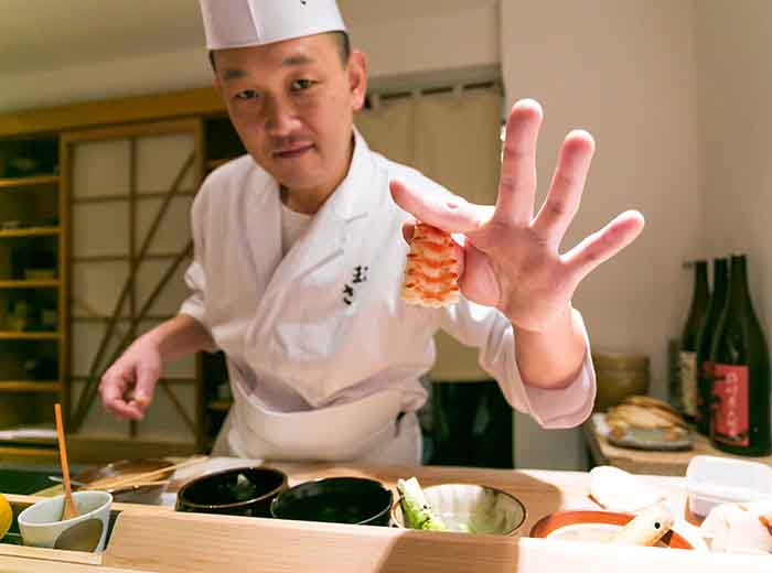 Sushi chef in Tokyo, Japan