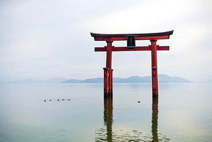 Torii gate on lake in Japan