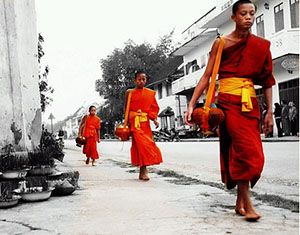 Art photograph of monks walking in Luang Prabang, Laos
