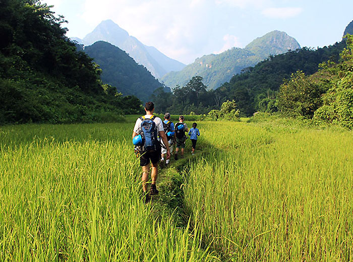 Group hiking in Muang Ngoi, Laos