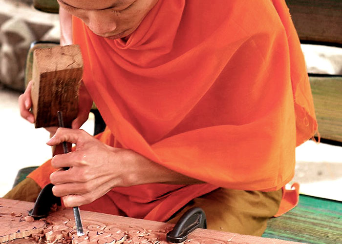 Monk wood carver in Laos