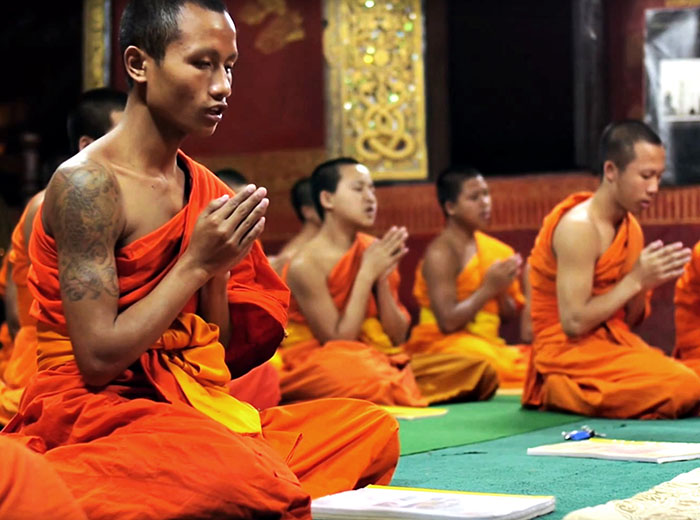 Monks meditating in Laos