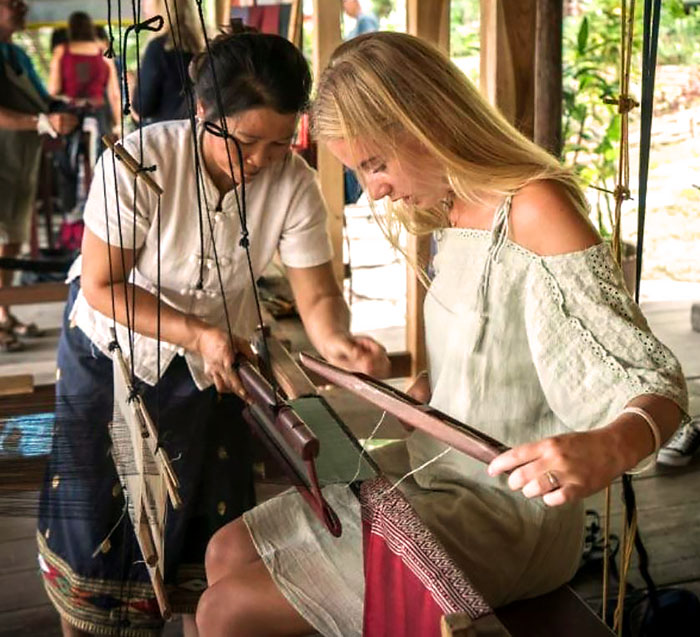 Weaving textiles at Ock Pop Tok silk commune in Luang Prabang, Laos