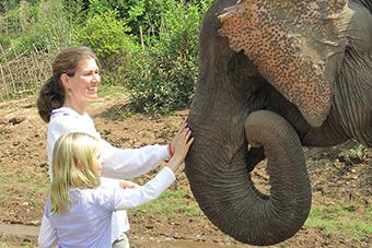 Family visiting elephant camp in Luang Prabang, Laos