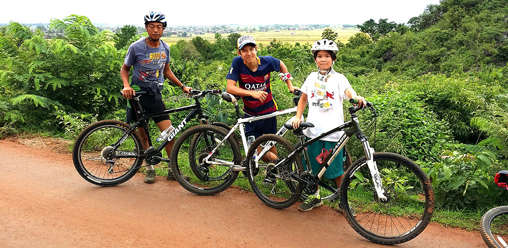 Family cycling tour on Inle Lake, Myanmar