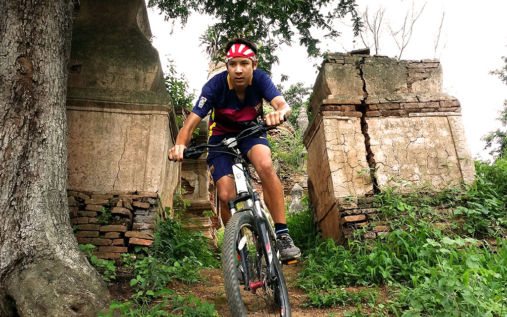 Mario Morris mountain biking at Inle Lake temple complex