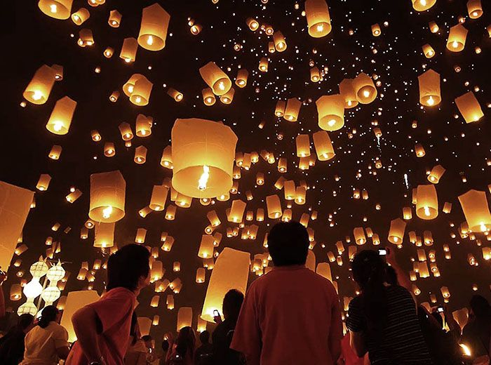 Fire lanterns rising into the niight sky during Myanmar's Festival of Lights