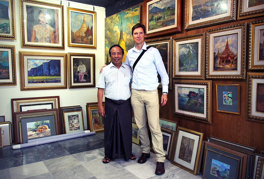 Burmese artist U Tin Win in his Yangon gallery with Patrick Morris