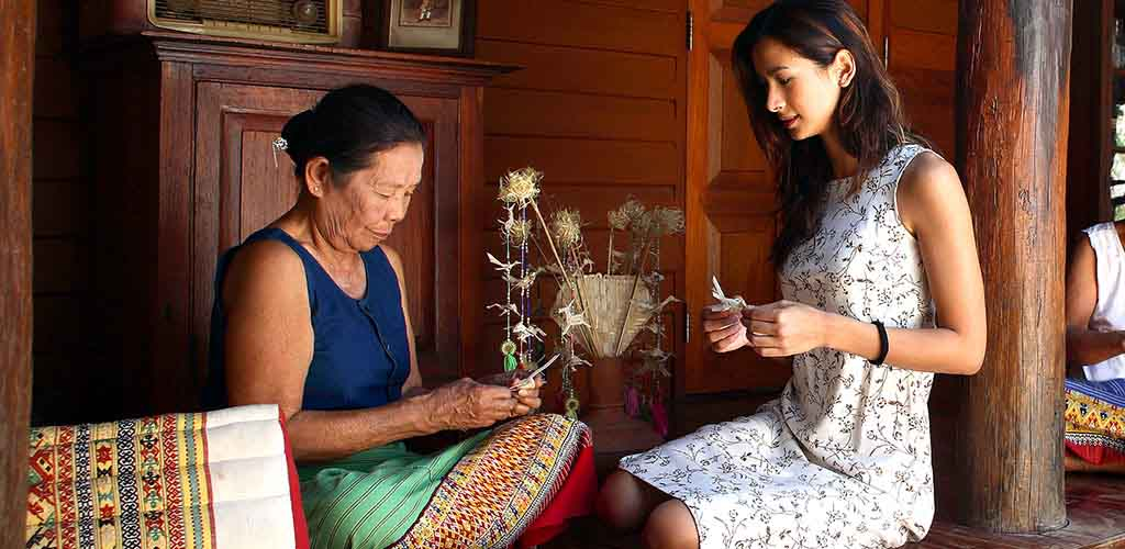 Teen learning crafts in Chiang Mai, Thailand during family tour
