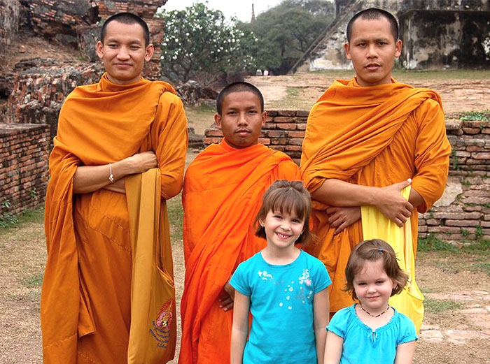 Family with monks in Thailand