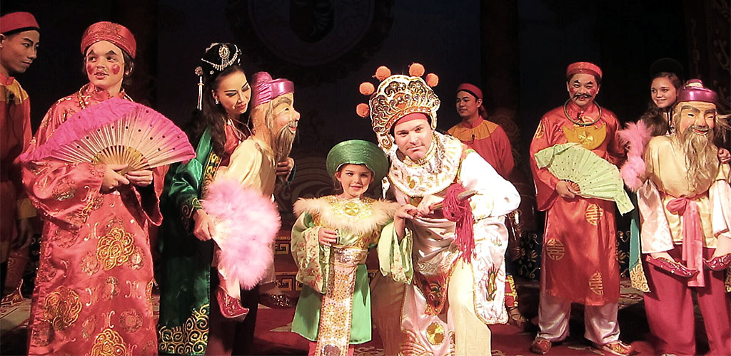 Performing with Hanoi theater troupe during Vietnam family tour