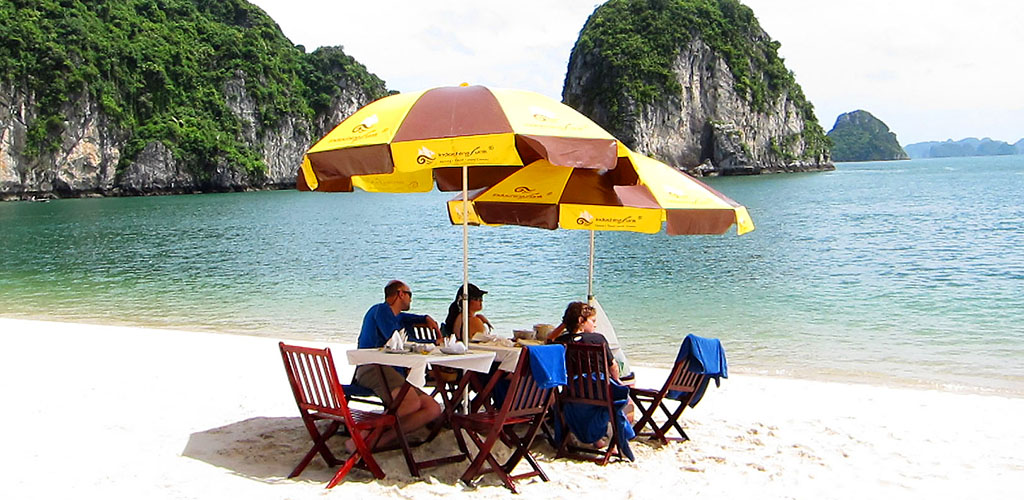 Luxury beach dining on Halong Bay