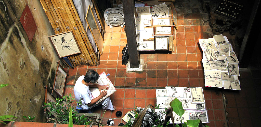 Vietnamese artist sketching in home studio