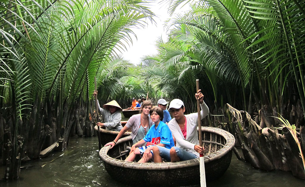 Bamboo boat ride during Vietnam family tour