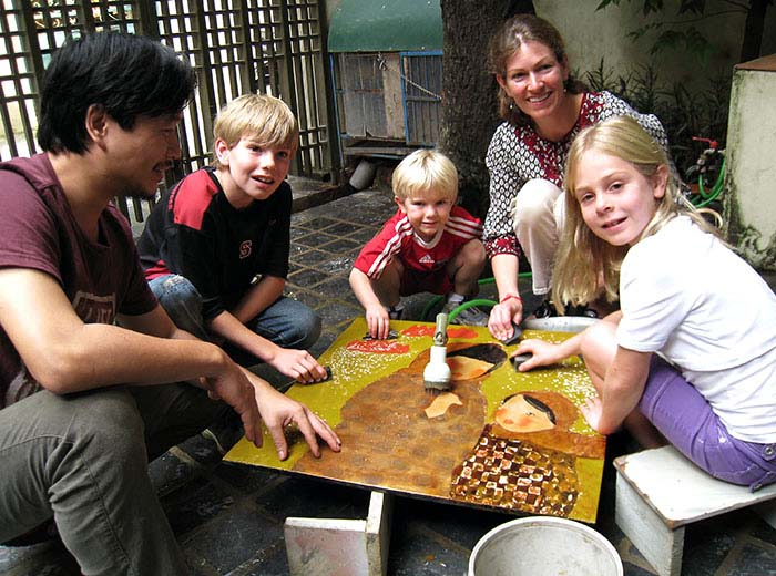 Family meeting with artist in Hanoi, Vietnam to learn lacquer