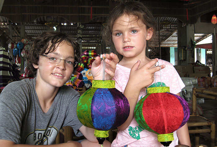 Children making traditional lanterns in Hoi An, Vietnam