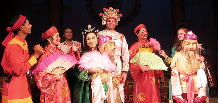 Family tour of traditional opera house in Hanoi, Vietnam