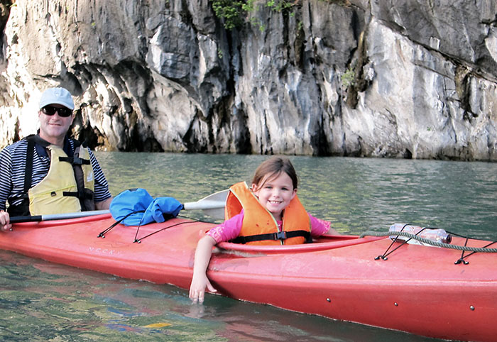 Family kayaking on Halong Bay, Vietnam