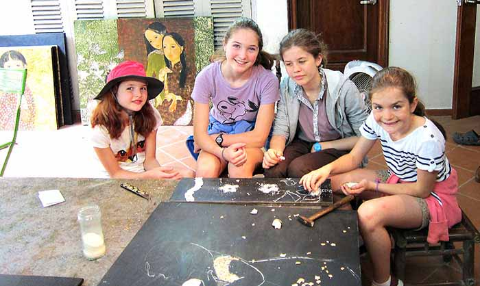 Children learning lacquer in Hanoi, Vietnam