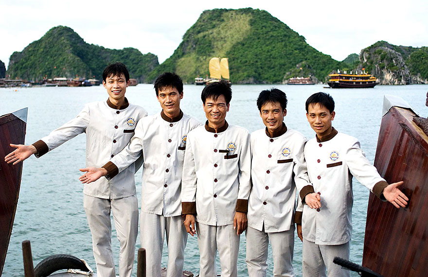 Crew aboard a luxury cruise ship on Halong Bay.