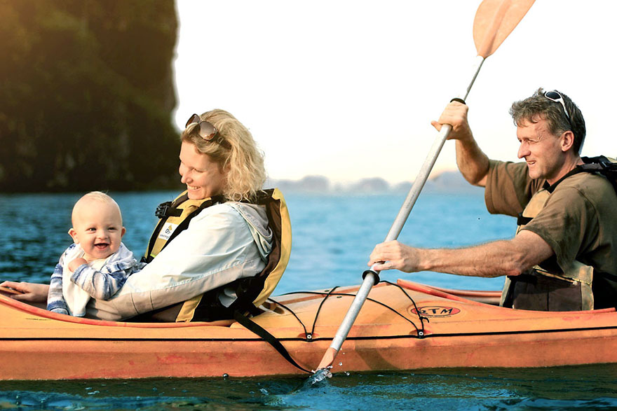 Family kayaking on Halong Bay