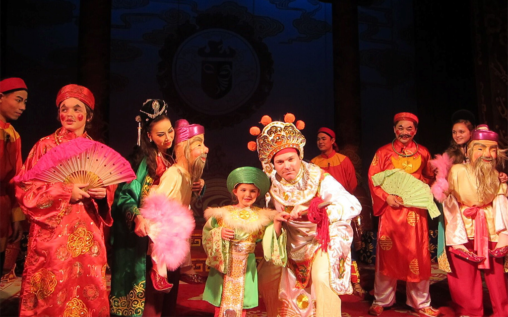 Family tour Vietnam acting in Vietnamese traditional opera